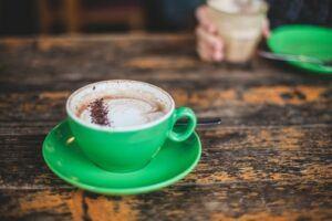 coffee in green mug on green saucer