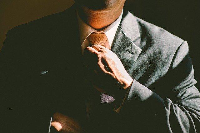 business man fixing tie
