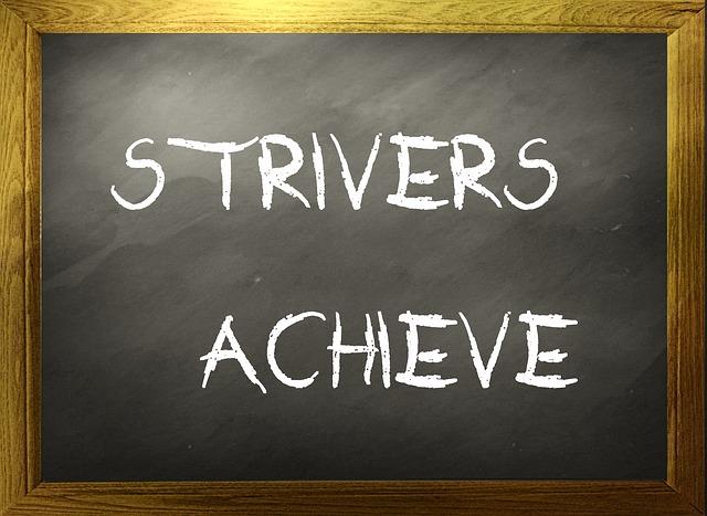 'strivers achieve' written on black board