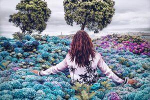 Woman in beautiful field of flowers